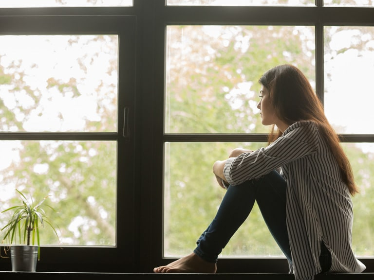Anxiety Disorder Treatment San Diego, CA Woman with Anxiety Looks Out Window
